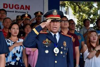 Col. Dugan doing a salute