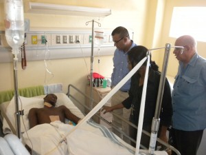 Minister of Natural Resources and the Environment, Robert Persaud visits Bosai accident victim Marlon Pollydore at the Linden Hospital