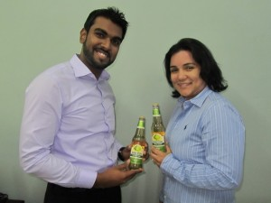 CEO, Irzad Zamal (left) and Executive Director, Arianna Pereira display the Apple Cider. [iNews' Photo]