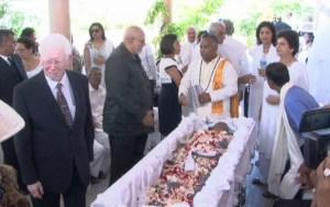 President Ramotar views the body of Mr. Singh.