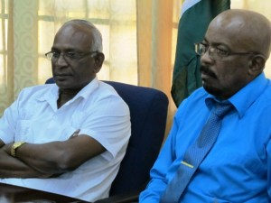 L - R: Ministers Ganga Persaud and Norman Whittaker.