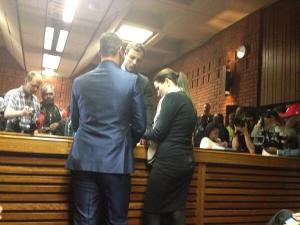 Pistorius sister appears to be reciting a prayer. [NBC Photo]