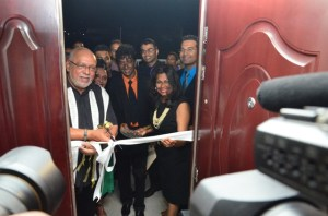 President Donald Ramotar, assisted by Mr & Mrs Clive Jagan cuts the ribbon to officially open the Jagan Dental Center.