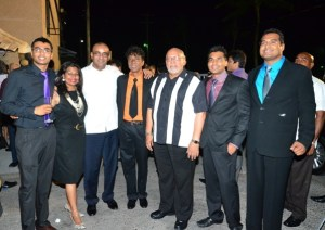 Dr Clive Jagan and Mrs Carol Jagan and sons with President Donald Ramotar and Former President Bharrat Jagdeo.  At extreme left is Ian Jagan while at extreme right is Shane Jagan and  Kyle Jagan.