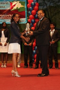 Zimeena Rasheed receives her PYARG Gold Award from Minister of Culture, Youth and Sport Dr. Frank Anthony.