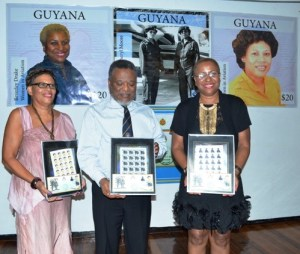 Prime Minister Samuel Hinds flanked by Cheryl Moore and Beverley Drake in whose honour commemorative stamps were launched.