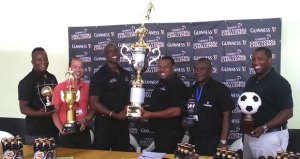 Brand Executives and Representatives pose with the trophy.