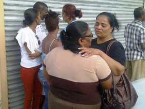 Relatives weep at the scene. [iNews' Photo]