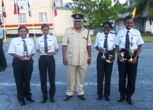 The winning team, along with Assistant Commissioner (administration),  Balsam Persaud.