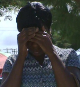 Sarah Abell hides her face as she exits the Georgetown Magistrate's Court. [iNews' Photo]