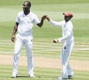 Darren Sammy celebrates a wicket with Shinvarine Chanderpaul