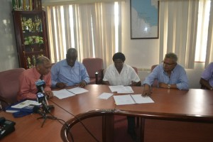 Minister of Agriculture Dr. Leslie Ramsammy witnesses the signing of the contracts for the design and supervision of the Parika-Ruby, Laluni and Onverwagt roads.