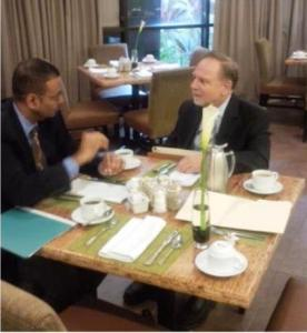 Minister Robert Persaud meeting with Mr.  Wayne Rassner, Vice Chairman of the Board of Trustees & Chairman of the Grants Committee for the South Florida National Parks Trust. December 20, 2013