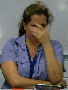 Chief Finance Manager of Trans Guyana, Nicola Corriea breaks down in tears during the press conference. [iNews' Photo]