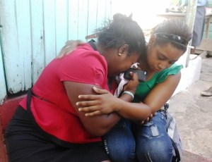 Home Owner Vanessa is being comforted by a relative. [iNews' Photo]