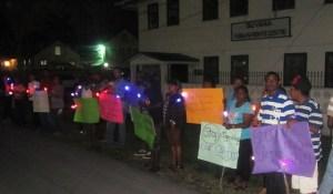 Persons gathered at the vigil. [iNews' Photo]