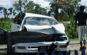 The damaged car, which was parked at the side of the road.