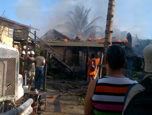 Residents look on as the building is engulf in flames.