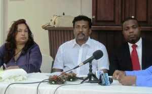 Mr & Mrs Bhaskaran along with their Attorney, Dexter Todd during the press conference. [iNews' Photo]