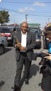 Speaker of the National Assembly ,Raphael Trotman receives the Queen's Baton. [iNews' Photo]
