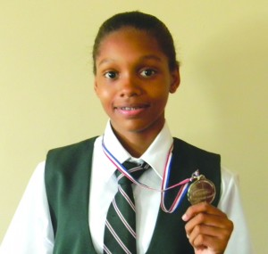 Chelsea-Edghill shows off her medal.