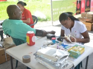 A staff of the Ministry of Health conducting a blood pressure test