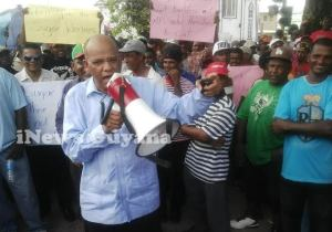 General Secretary of the PPP, Clement Rohee leads the protest in front of Parliament.