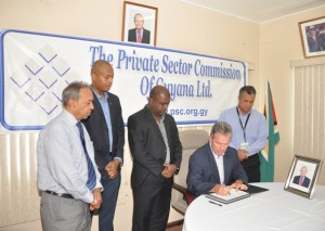 British High Commissioner, Andrew Ayre, signing the Book of Condolences
