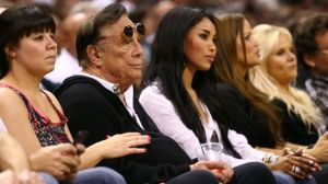 Team owner Donald Sterling of the Los Angeles Clippers and V. Stiviano watch the San Antonio Spurs play on May 19, 2013 in San Antonio, Texas.