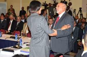 Jamaica's Prime Minister Portia Simpson-Miller embraces President Donald Ramotar