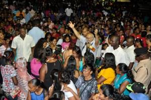 President Donald Ramotar greets Guyanese at the IAC Mela.