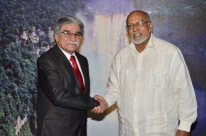 President Donald Ramotar greeting Non-resident Bolivian Ambassador Jerjes Justiniano Talavera