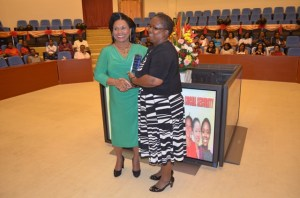 Lydia Green receiving her plaque from Mrs. Hinds