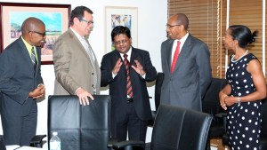 Minister of Finance, Dr Ashni Singh, meets with Dr Warren Smith, President of the CDB (second from left) and other senior Staff at the CDB Headquarters in Barbados.
