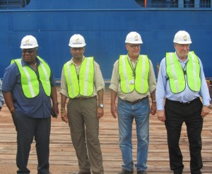 Minister Robert Persaud along with other officials.