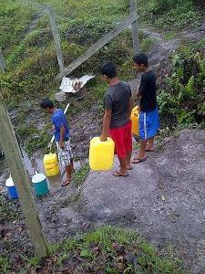 PK children fetching water