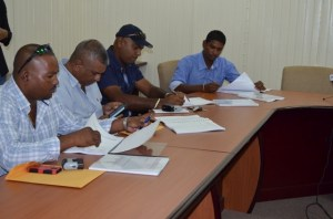 Four of the contractors representing the various companies signing the contract during the event.