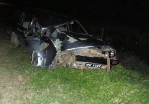 The badly damaged car on the parapet of the Jibb public road,  Essequibo Coast.