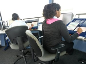From left to right – Mrs. Francesca Wilson and Ms. Jennita Bhagwandin at the control position in the Timehri Control Tower.