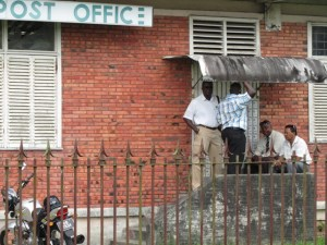 Investigators outside the Post Office. [iNews' Photo]