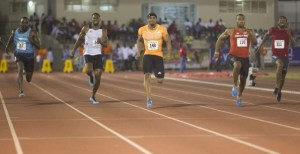 Adam Harris (centre) leads the way in the mens 100 M at the second annual BVI Invitational