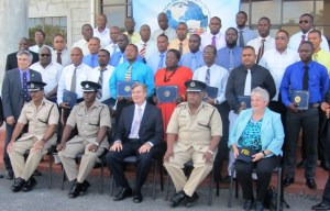 US Ambassador to Guyana, Brent Hardt along with officers of the Guyana Police Force. [iNews' Photo]