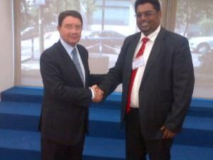 Minister Irfaan Ali (R) greets UNWTO Secretary General (L)