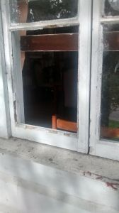 The broken window through which the thieves gained entry