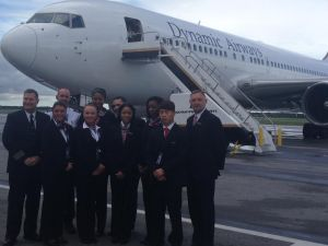 The Crew stands in-front the Boeing 767