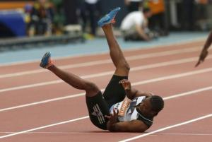 Yohan Blake of Jamaica falls injured in the men's 100m during the IAAF Diamond League athletics meeting at Hampden Park in Glasgow July 11, 2014.  [Reuters Photo]