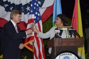 Acting Minister of Foreign Minister  Priya Manickchand and outgoing United States Ambassador to Guyana, Brent Hardt sharing a toast shortly after her stinging attack.
