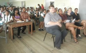 Charge d' Affaires of the United States Embassy, Bryan Hunt along with students at the school/ [iNews' Photo]