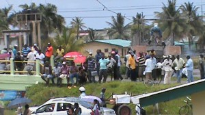 Rice farmers protesting for immediate payments for their paddy on Friday at Anna Regina.