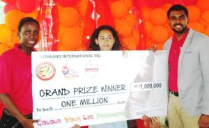 Winner of the promotion, Pere DeRoy (center) along with CEO of Southland International, Irzad Zamal (right).